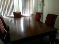 rectangular brown wooden table with six chairs  Los Angeles, 90047