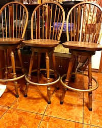 two brown wooden windsor chairs Houston, 77015