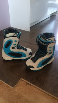 pair of white-blue-and-black snowboard boots