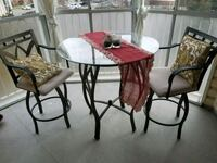 round glass top table with four chairs dining set Kelowna, V1W 3R4