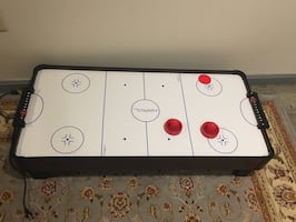 White and black air hockey table