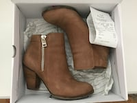 pair of brown leather chunky heeled boots in box