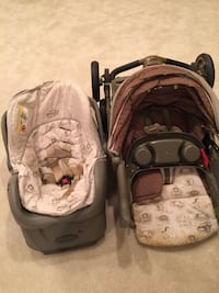 baby's two pink and gray car seat carriers Fairfax, 22030