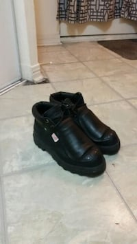 pair of black leather boots Mississauga, L4Z 3E9