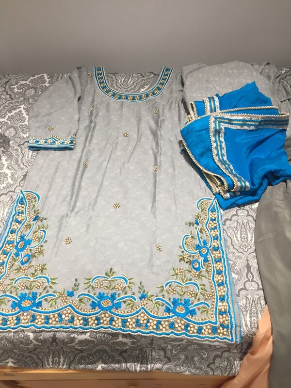 Gray and blue traditional cloth 145ed95d-c3dc-4670-9ffd-f0eb4b6d785d