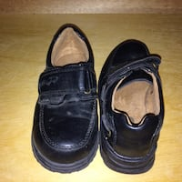 boy's pair of black leather dress shoes