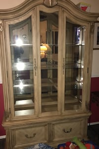 Cabinet with lighted shelves