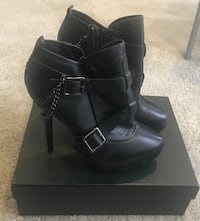 pair of black leather heeled booties with box 12 km