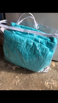 Size queen Nicole Miller teal quilt and two pillow shams never used