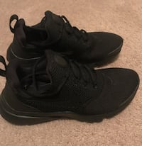 pair of black Nike running shoes Houston, 77084