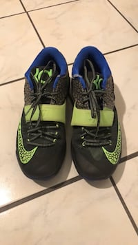 pair of black-and-green Nike running shoes Spring, 77379