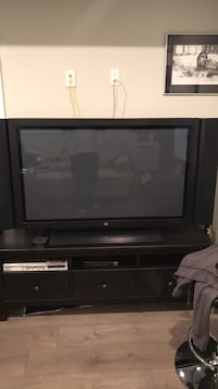 Black wooden tv stand with flat screen television Coquitlam, V3J