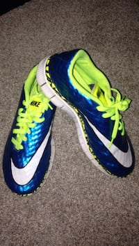 pair of blue-and-green Nike cleats