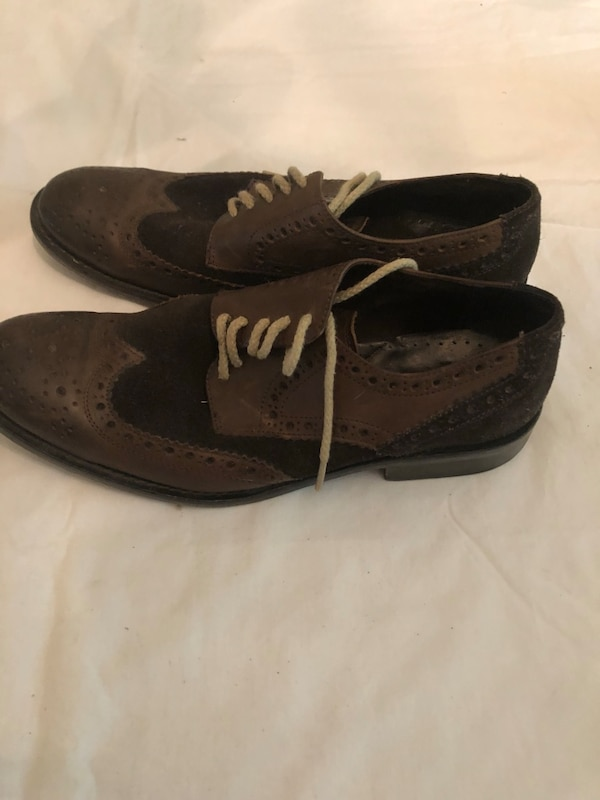 pair of black-and-brown leather shoes