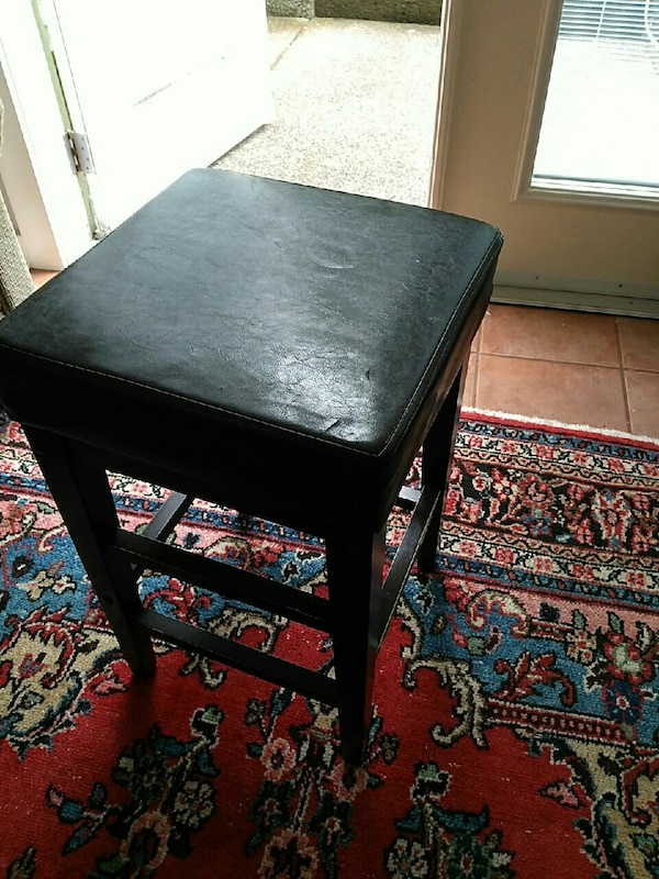 square black padded wooden seat