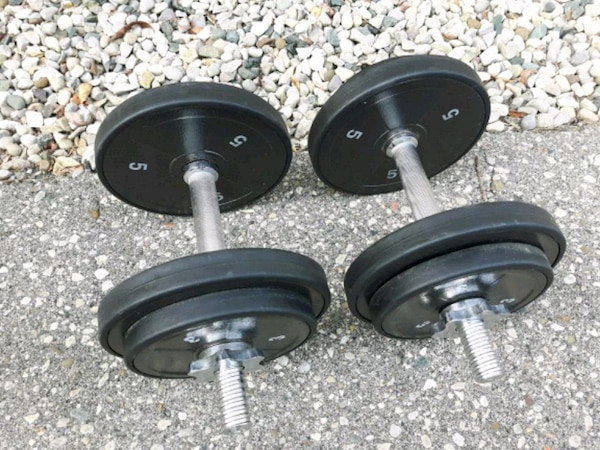 two black dumbbells and barbell