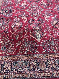 red, white, and black floral area rug Hickory