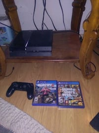 black Sony PS4 console with controller and games Niagara-on-the-Lake, L0S 1J0