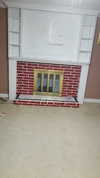 red and white brick woo framed electric fireplace