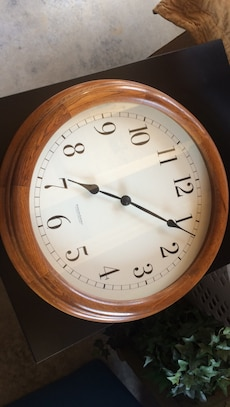 Round analog wall clock with brown frame
