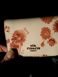 Coach.trifold wallet...pd $150