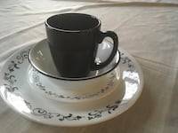 white and black ceramic teacup and saucer London, N6G