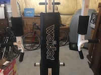 Black and white total gym exercise equipment