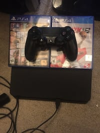 black Sony PS4 console with controller and game cases Newark, 19711