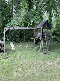 brown and blue wooden swing and slide