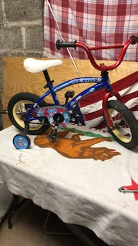 toddler's blue and red bicycle with training wheels Joplin, 64801