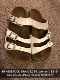 pair of white-and-brown leather sandals