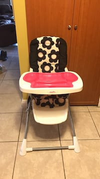 baby's white and pink high chair