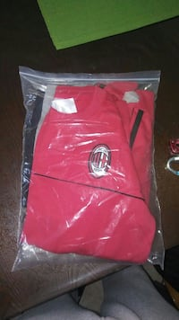 red and black apparel with pack Montréal, H1R 2X3