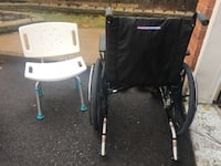 Black wheelchair and transfer bench