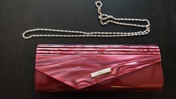 Wine-red clutch purse with removable chain strap