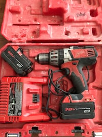 Red and black cordless hand drill in case Laval, H7K