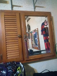 brown wooden cabinet with mirror Batavia, 14020