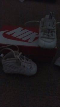 pair of white-and-black Nike basketball shoes Decatur, 30032
