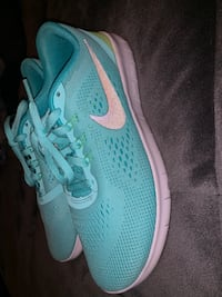 Pair of teal nike running shoes Alexandria, 22306