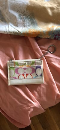 white and pink Coach leather wristlet Midland, 79707