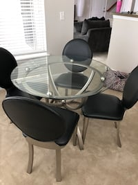 round glass top table with four chairs dining set Clarksburg