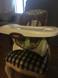 brown and green Fisher-Price floor seat