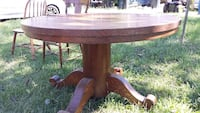"52""Oak dinning table also have matching chairs Fayetteville, 28303"