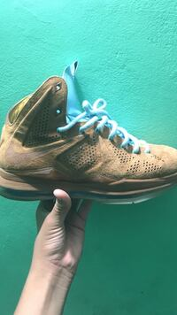 Unpaired brown and blue lace-up nike basketball shoe
