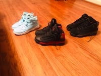 three pairs of assorted-color basketball shoes 1021 mi