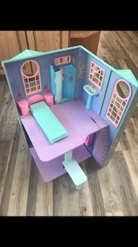purple, teal, and blue plastic dollhouse