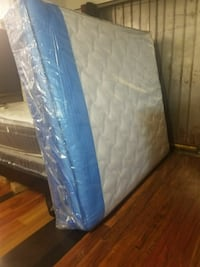 quilted white and blue mattress