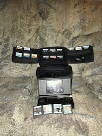 black Nintendo DS with game cartridges Antioch, 94509