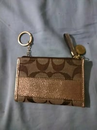 brown and beige Coach monogram wristlet Lubbock, 79413