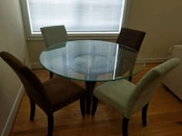 round glass top table with four chairs dining set Richmond, 23221